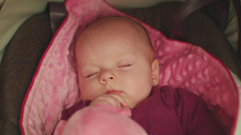 Peaceful Baby Sleeping in a Car Seat Filmmaterial