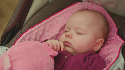 Adorable Sleeping Baby on a pink blanket Footage