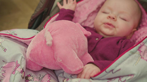 Sleeping Baby with Toy Spins Her Head Footage