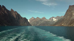 Greenland Prince Christian Sound 102 wide stern wave between mountains Footage
