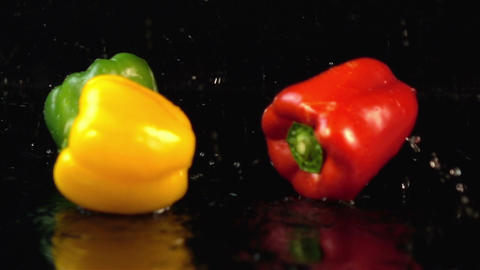 Four videos of falling bell pepper in real slow motion Footage