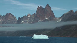 Greenland Prince Christian Sound 107 iceberg and low stratus in fjord Footage