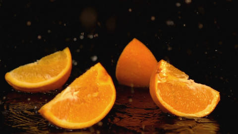 Three videos of falling oranges in real slow motion Footage