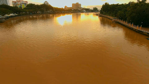 Sarawak River dyed in sunset, Dolly up from the river Footage