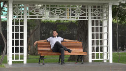 Man Sitting On Park Bench Footage