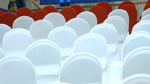 Chairs in White and Red Covers Set out in Rows Footage