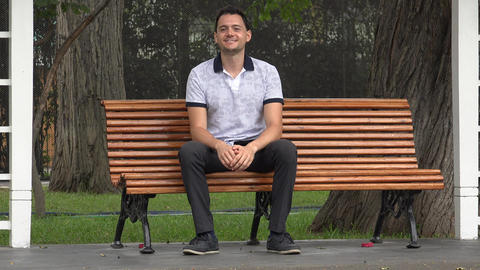 Happy Man Sitting On Bench Footage