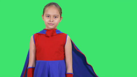 Young girl superhero standing on greenscreen fold arms- Live Action