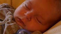 newborn baby sleeping closeup camera motion Footage