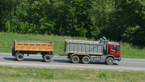 Dumper with a trailer driving on a road Footage