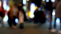 Blurred video of crowded city street with people moving Footage