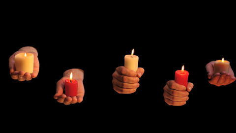 Many hands with burning candles on black background ビデオ