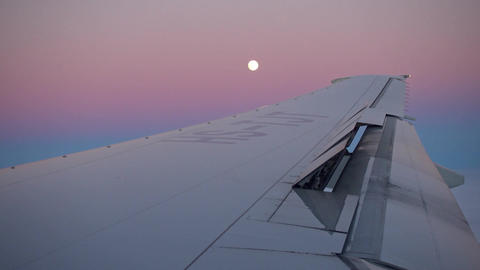 Wing of aircraft and moon after sunset Footage