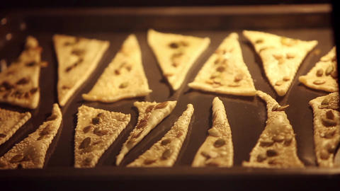 Triangles of puff pastry inside oven Live Action