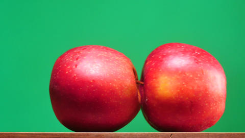 indecent apples motion on table chroma key dolly shot. Can be applied for abstra Footage
