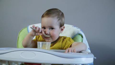 Cute little baby girl eating her porridge Footage