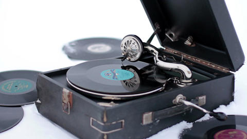 Old Gramophone Record Playing in the snow Live Action