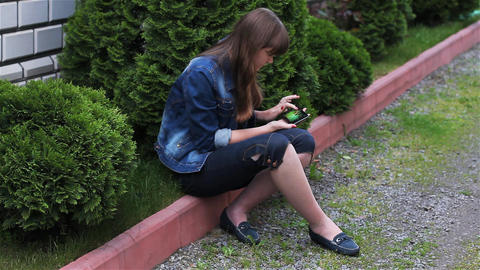 Girl With Mobile Phone In The Garden 4 Footage