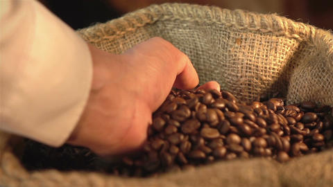 Video of taking coffee beans in real slow motion Footage