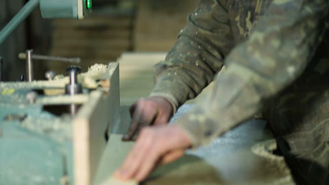 Skilled carpenter working on wood milling machine Footage