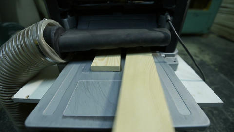 Wood planks after planing with electric planer Footage