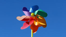 Toy windmill in blue sky Footage