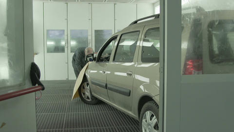 Skilled Mechanic Repairs Automobile in Service Station Footage