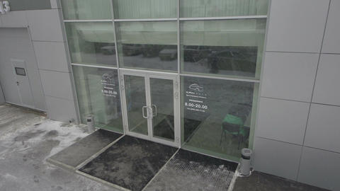 Closeup Glass Entrance to Bank Office and Client Goes out Footage