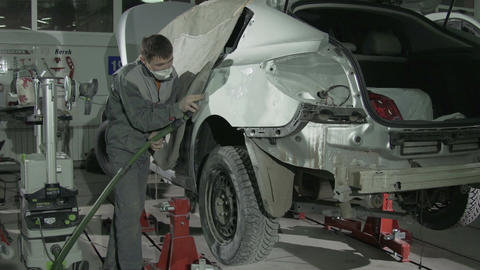 Skilled Worker in Mask Polishes Large White Car Side Footage