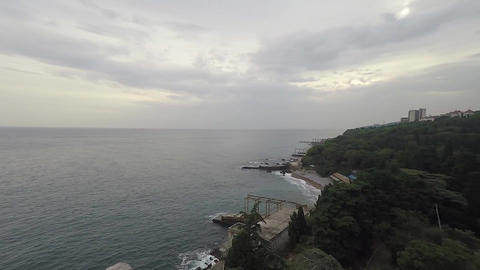 Aerial drone shot: Flying over tranquil sea with cloudy sky in the background 画像