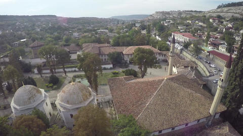 Aerial view on the old city with church before sunset, sunrise. Fog, Cloudy sky Footage