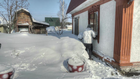 Man shoveling snow after snow storm Archivo