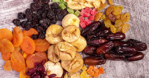 Mix of dried fruits on wooden background Footage