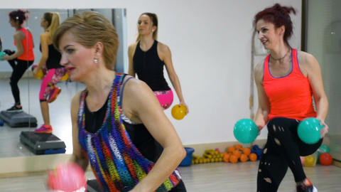 Mature women exercising together at the fitness gym Footage