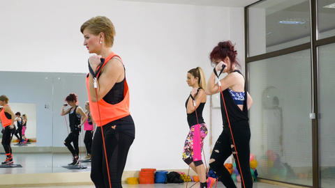 Group of women doing healthy lifestyle aerobics training together Footage