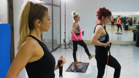 Young attractive women dressed in fitness equipment working out at the gym Footage