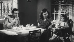 USA 1940s: Family Dining Together, Child Drinks Glass of Milk Filmmaterial