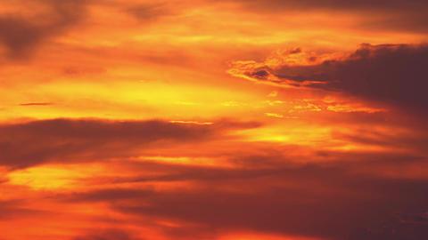Orange sunset. Beautiful sky illuminated by last beams of setting sun Footage