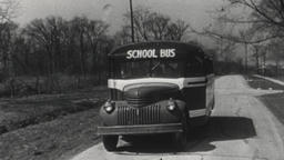 USA 1940s: School Bus Traveling on Rural Road Footage