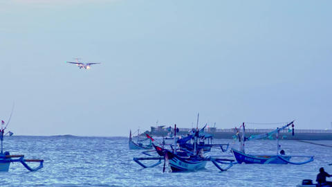 Turboprop airplane landing along runway of Ngurah Rai airport. Bali, Indonesia Footage