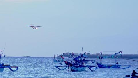 Turboprop airplane landing along runway of Ngurah Rai airport. Bali, Indonesia Footage