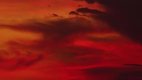 Clouds illuminated by faint light of setting sun slowly float Footage