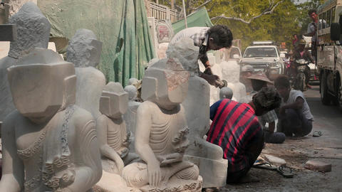Street of Mandalay city in Myanmar with marble artisan works around Live Action