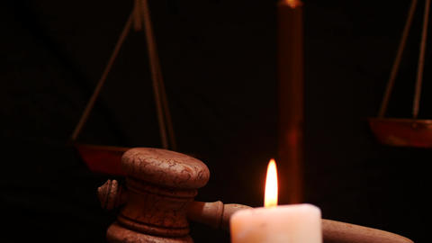 Gavel scales and candle black background dolly shot Footage