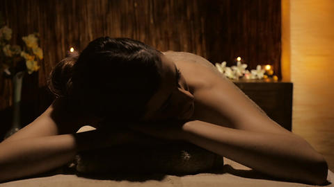 Gorgeous young lady relaxing in spa in luxury hotel Footage