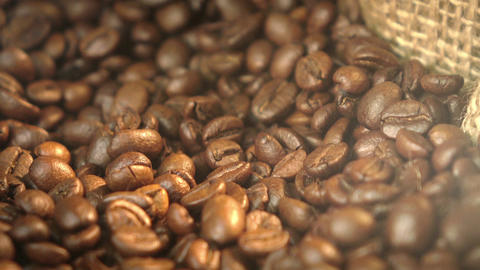 Two videos of rotating coffee beans in 4K Footage