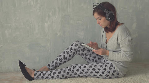 Beautiful young woman listen music in earphones Footage