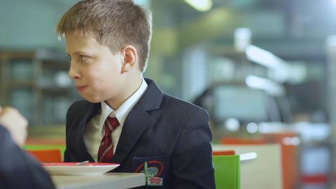Closeup Schoolboy Eat Porridge and Drink in School Cafeteria Footage