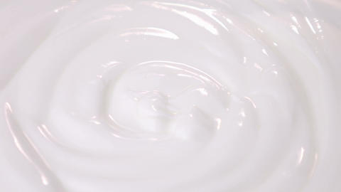 Loopable video of swirling yogurt in 4K Footage