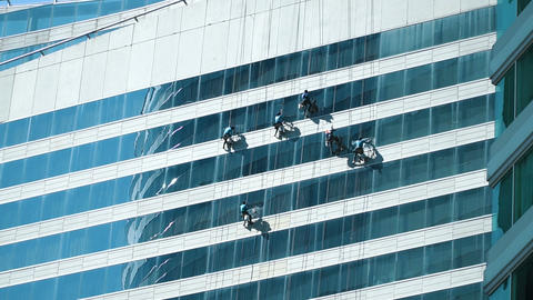 Workers washing the windows facade Footage